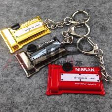 Брелок - Крышка двигателя Nissan